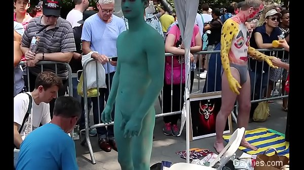 Naked Asian Lad's body is painted in public